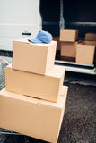 Trolley with boxes against truck, male logistic. Trolley with carton boxes against truck . Distribution business. Cargo delivery. Empty, clear containers. Mail Royalty Free Stock Photography
