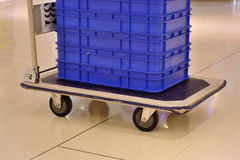 Trolley with boxes in warehouse Royalty Free Stock Photography