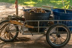 Trolley Bucket Leaves. With a lot of leave in basket Stock Photo