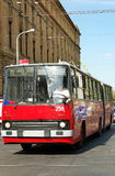 Trolley-bus. Red trolley-bus in Budapest (Hungary) crossing tram lines royalty free stock image