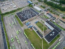 Trolley and bus depot in Kaunas, Lithuania. Aerial view. A lot of green trolley from above. Aerial view of bus deport in Kaunas, Lithuania Royalty Free Stock Image
