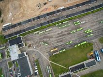 Trolley and bus depot in Kaunas, Lithuania. Aerial view. A lot of green trolley from above. Aerial view of bus deport in Kaunas, Lithuania Stock Photo