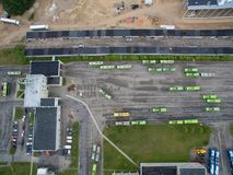 Trolley and bus depot in Kaunas, Lithuania. Aerial view. A lot of green trolley from above. Aerial view of bus deport in Kaunas, Lithuania Stock Photography