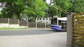 Trolley bus going along street city traffic transportation stock video
