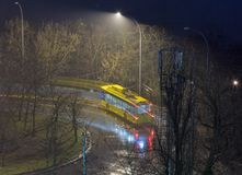 Trolley bus at night in park. Trolley bus on street at night in bad weather Stock Photos