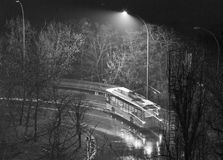 Trolley bus at night in park. Trolley bus on street at night in bad weather in black and white Stock Photography