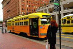 Trolley car. Woman standing waiting for the trolley car stock photography