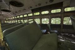 Trolley car abandoned in woods. Seats and debris inside abandoned trolley car in woods Royalty Free Stock Photos