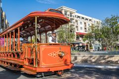 Trolley car at the Americana at Brand. Glendale, CA: May 8, 2018: Trolley car at The Americana at Brand, a luxurious retail and entertainment-based shopping Stock Photos