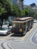 Trolley Car Climbing a San Francisco Hillside. Tracks curve and climb the streets of San Francisco carrying trolley cars Stock Photos