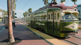 Trolley Car in San Diego. A trolley car in san diego california in front of the convention center in the historic gaslamp district stock video footage