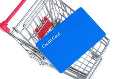 Trolley with card. Shopping trolley with credit card Royalty Free Stock Photography