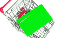 Trolley with card. Shopping trolley with credit card Stock Photos