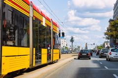 Trolley and cars in road in Warsaw city center. Trolley and cars in the road in Warsaw city center in Poland royalty free stock photo