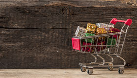 Trolley cart with gift boxes Stock Photo