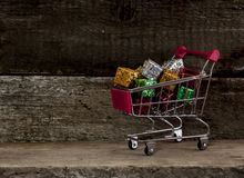 Trolley cart with gift boxes Royalty Free Stock Photo