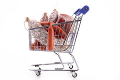 Trolley cart with meats Stock Images
