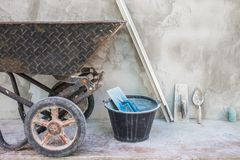 Trolley and cement tools for construction in site building area. Construction industry concept Stock Photography