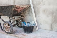Trolley and cement tools for construction in site building area. Construction industry concept Stock Images