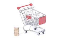 Trolley with coins Stock Photos