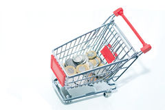 Trolley with coins. Royalty Free Stock Photo