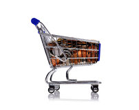 Trolley with coins Stock Images