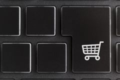 Trolley on computer keyboard key. Online shopping concept