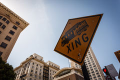 Trolley crossing street sign in San Francisco. Framed by modern high rise buildings Stock Image
