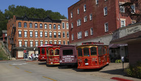 Trolley depot in historic Galena, Illinois. Trollys at the depot waiting for customers for a tour of historic Galena, Illinois Royalty Free Stock Photo
