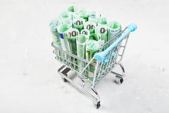 Trolley with euro banknotes on concrete plate Royalty Free Stock Photo