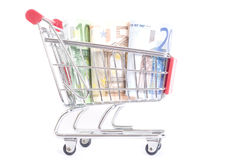 Trolley with euros. Shopping cart with euro banknotes on white Stock Photo