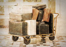 Trolley full of old luggage Royalty Free Stock Image