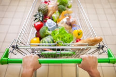 Trolley full of products Stock Photography