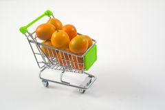 Trolley full of tangerines Royalty Free Stock Photography