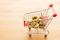 Trolley with gold coin Royalty Free Stock Photos