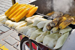 Trolley with grilled corns. Stock Photography
