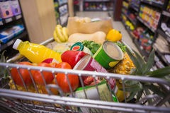 A trolley with healthy food. At supermarket Royalty Free Stock Photos