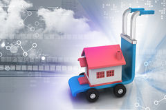 Trolley with house. In color background Royalty Free Stock Images