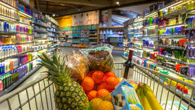 Trolley In Supermarket With Food Products Stock Images