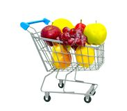 Mini shopping cart filled with fruits isolated on white background royalty free stock images