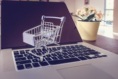 Trolley on a laptop keyboard., Shopping online and business e-commerce concept.  royalty free stock photo
