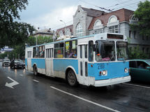 The trolley on Leningradskaya street in Khabarovsk. White & blue trolley after the rain Stock Photo
