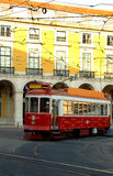 Trolley on lisbon portugal street. A red trolley on a street in a historic neighborhood in Lisbon, Portugal Royalty Free Stock Photography
