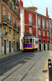 Trolley on lisbon portugal street. A red trolley on a street in a historic neighborhood in Lisbon, Portugal Royalty Free Stock Images