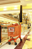 Trolley at the mall. Orange trolley at Euroma 2 shopping center in Rome during sale Stock Photos