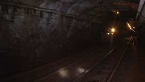 Trolley in the mine goes on rails 2 stock footage