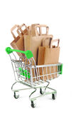 Trolley with paper bags  isolated Stock Photography