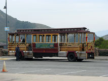Trolley in parking lot Royalty Free Stock Photography