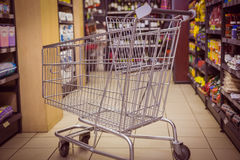 Trolley with product on shelf Stock Photography