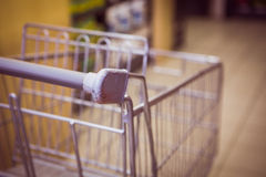 Trolley with product on shelf Royalty Free Stock Images